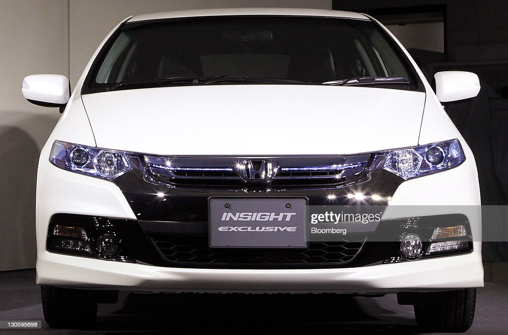A Honda Motor Co Insight Exclusive Hybrid Car Is Displayed During An Unveiling In Tokyo