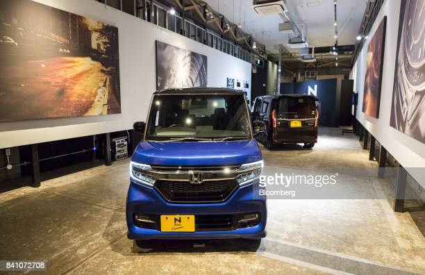 Honda Motor Co. N-Box minicars sit on display during a media preview in Tokyo, Japan, on Tuesday, July 4, 2017. Honda will start to sell the new...