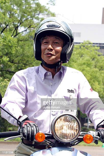 Honda Motor Co President Hiroyuki Yoshino rides a Honda's new scooter Today at a press conference July 22 Tokyo Parts for Today are produced in...