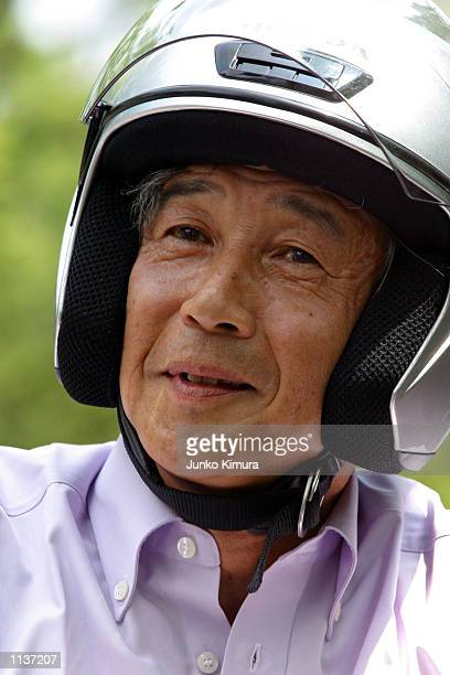 Honda Motor Co President Hiroyuki Yoshino rides Honda's new scooter Today at a press conference July 22 Tokyo Japan Parts for Today are produced in...