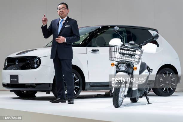 Honda Motor Co. President Takahiro Hachigo speaks in front of the company's Honda E electric vehicle during a press conference at the Tokyo Motor...