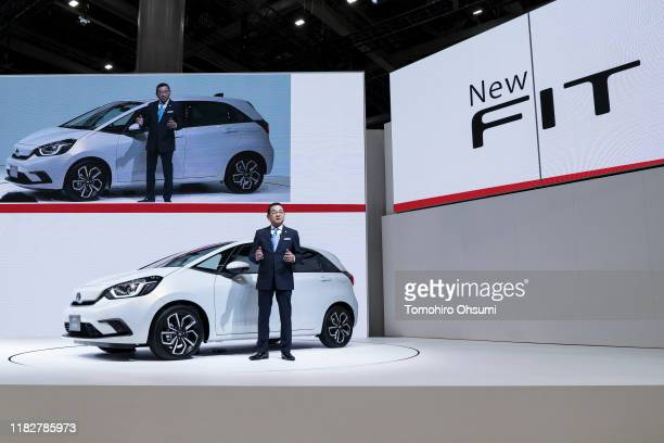 Honda Motor Co. President Takahiro Hachigo speaks in front of the company's redesigned Fit compact vehicle during a press conference at the Tokyo...