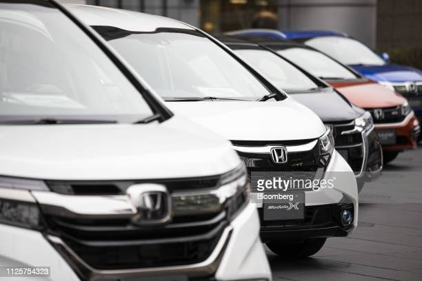 Honda Motor Co vehicles stand on display outside a showroom at the company's headquarters in Tokyo Japan on Tuesday Feb 19 2019 Honda said it plans...