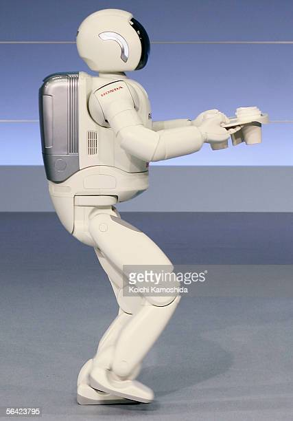 Honda Motor CoLtd's humanoid robot ASIMO is unveiled during a press conference on December 13 2005 in Tokyo Japan With the new capabilities developed...