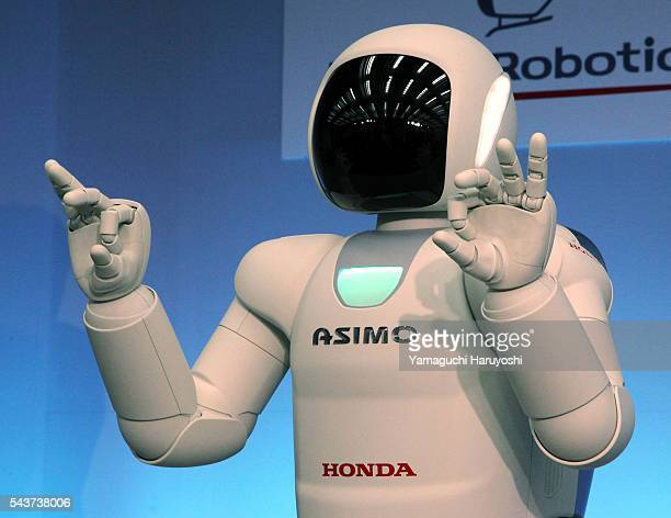 Honda Motor Co's human robot 'Asimo' demonstrates sign language during a news conference at the company's research facility in Wako near Tokyo...