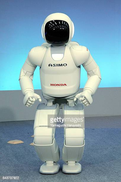 """Honda Motor Co.'s human robot """"Asimo"""" jumps during a news conference at the company's research facility in Wako, near Tokyo, Tuesday, Nov. 8, 2011...."""