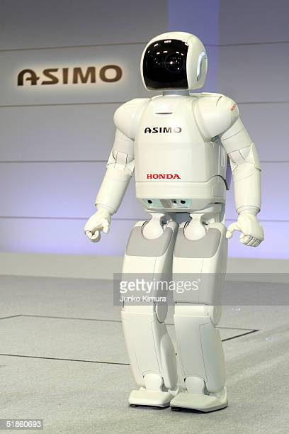 Honda Motor Co's humanoid robot Asimo appears during a press review December 15 2004 in Tokyo Japan Honda announced the development of new...