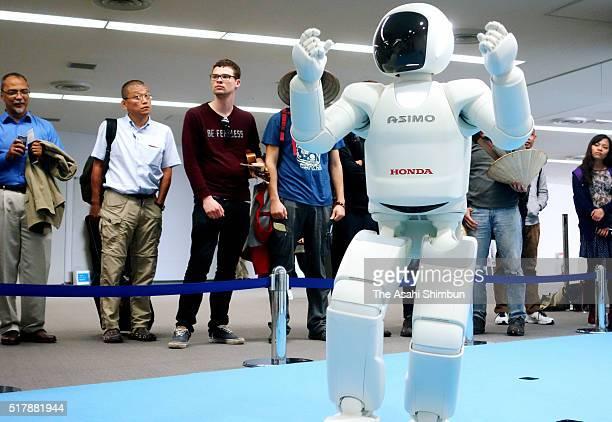 Honda Motor Co's humanoid robot ASIMO attracts visitors at the immigration of the Narita International Airport on March 28 2016 in Narita Chiba Japan