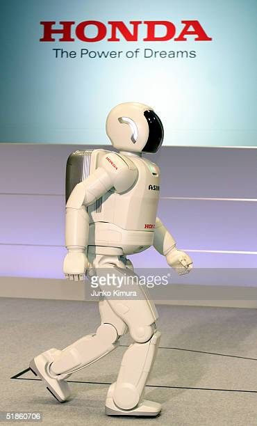 Honda Motor Co.'s humanoid robot, Asimo, moves at the speed of approximately 3km/hour during a press review December 15, 2004 in Tokyo, Japan. Honda...