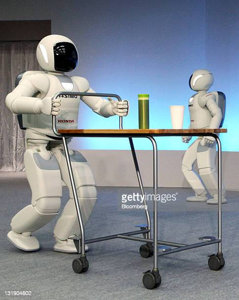 Honda Motor Co's new ASIMO robot wheels a drink on a trolley during a news conference in Wako City Saitama Prefecture Japan on Tuesday Nov 8 2011...