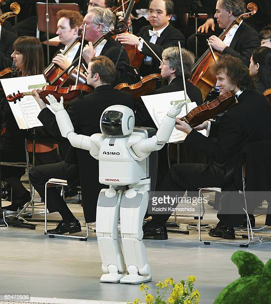Honda Motor Co's walking robot Asimo attends the opening ceremony of the 2005 World Exposition Aichi at Expo Dome on March 24 2005 at Nagakute town...