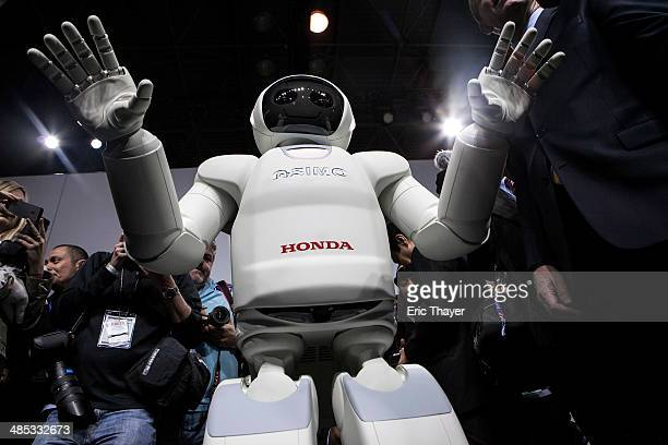 Honda Motors demonstrates its Asimo robot during a media preview of the 2014 New York International Auto Show in New York The show opens with a sneak...