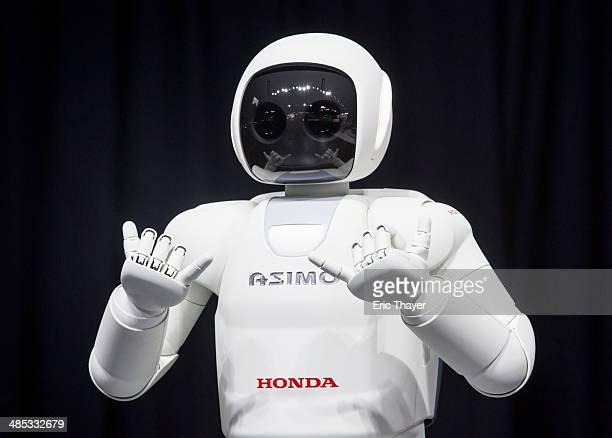 Honda Motors demonstrates its Asimo robot during a media preview of the 2014 New York International Auto Show in New York. The show opens with a...