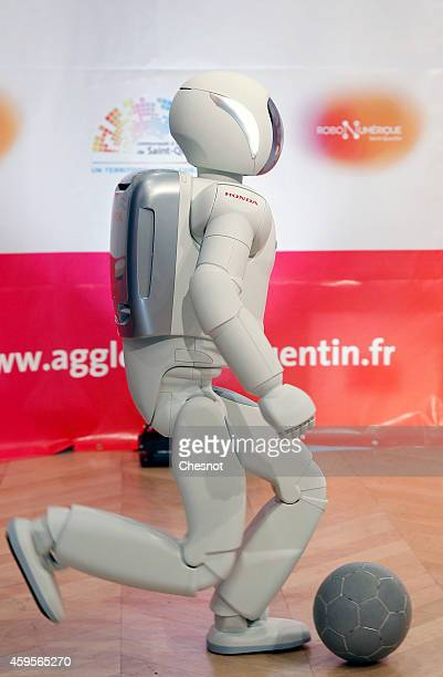 Honda Motors demonstrates its ASIMO robot during the 'Robonumerique' exhibition on November 2014 in St Quentin France ASIMO is a humanoid robot...