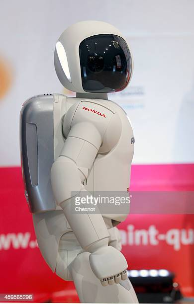 Honda Motors demonstrates its ASIMO robot during the 'Robonumerique' exhibition on November 2014 in St Quentin, France. ASIMO is a humanoid robot...