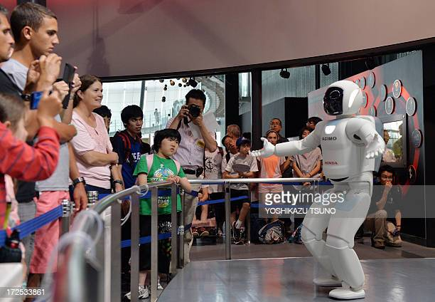 Honda Motor's humanoid robot Asimo interacts with visitors at the National Museum of Emerging Science and Innovation in Tokyo on July 3, 2013. Honda...