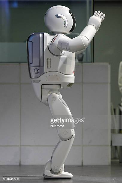 Honda Motor's new Asimo humanoid robot balances during a demonstration at the Honda headquarters in Tokyo 19 April 2015. The introduction of...