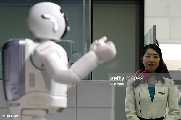 Honda Motor's new Asimo humanoid robot balances during a demonstration at the Honda headquarters in Tokyo 19 April 2015 The introduction of...