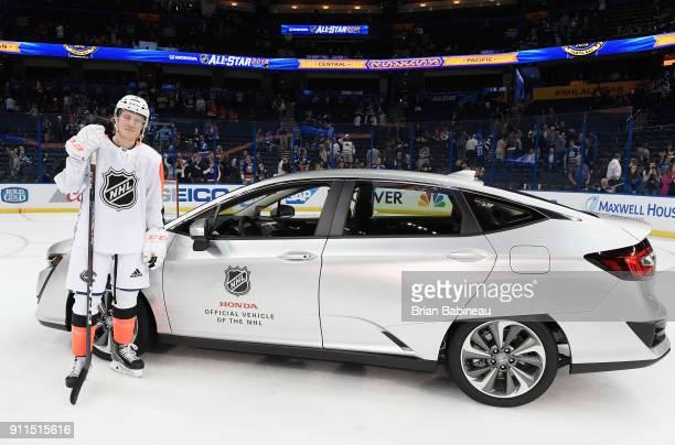 Honda NHL AllStar Game MVP Brock Boeser of the Vancouver Canucks stands next to his new Honda car after the 2018 Honda NHL AllStar Game between the...