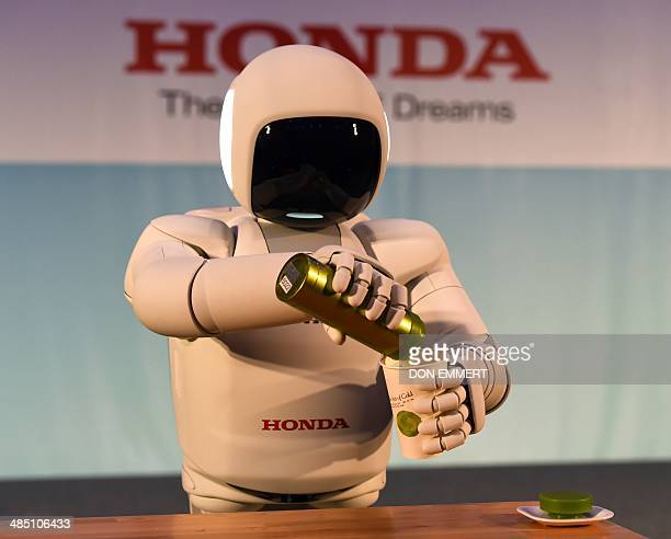 Honda North America makes their North American debut of their new Asimo Robot as it demonstrates its ability to pour a liquid at a news conference...