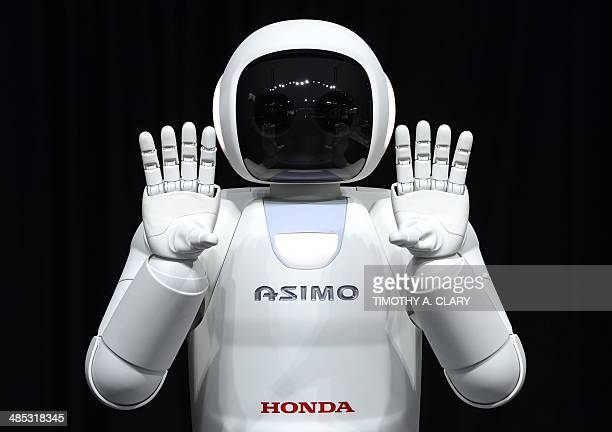 Honda North America shows off their new Asimo Robot along with their new Honda FIT to the media during the second press preview day at the 2014 New...