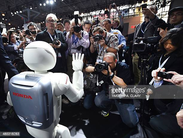 Honda North America shows off their new Asimo Robot to the media during the second press preview day at the 2014 New York International Auto Show...