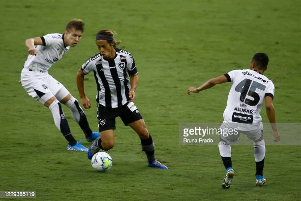Honda of Botafogo fights for the ball with Charles of Ceara during the match between Botafogo and Ceara as part of the Brasileirao Series A at...