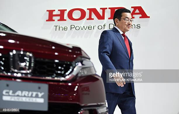 Honda president Takahiro Hachigo arrives onstage for a press conference during the Tokyo Motor Show in Tokyo on October 28 2015 AFP PHOTO / TOSHIFUMI...