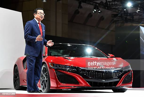 Honda president Takahiro Hachigo introduces the company's new NSX sports car at the Tokyo Motor Show in Tokyo on October 28 2015 AFP PHOTO /...