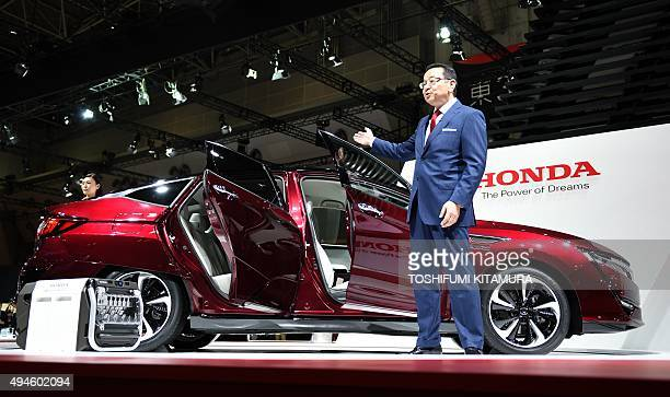 Honda president Takahiro Hachigo introduces the company's stock model of the fuel cell vehicle Clarity at the Tokyo Motor Show in Tokyo on October 28...