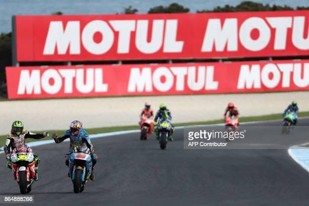 LCR Honda rider Cal Crutchlow of Britain and EG 00 Marc VDS Honda rider Jack Miller of Australia gesture at the end of the Australian MotoGP Grand...