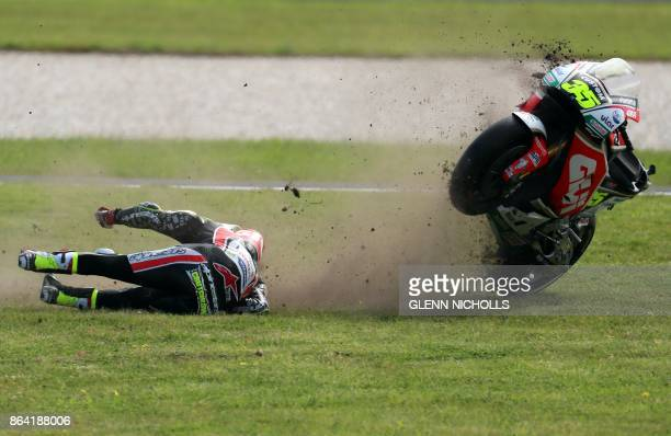 Honda rider Cal Crutchlow of Britain crashes during the second qualifying session of the Australian MotoGP Grand Prix at Phillip Island on October 21...