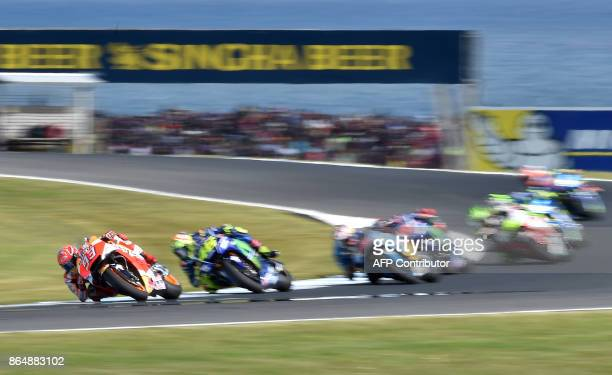 Honda rider Marc Marquez of Spain leads the pack during the Australian MotoGP Grand Prix at Phillip Island on October 22 2017 / AFP PHOTO / PAUL...