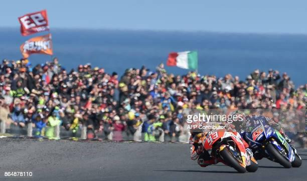 TOPSHOT Honda rider Marc Marquez of Spain leads Yamaha rider Maverick Vinales of Spain during the Australian MotoGP Grand Prix at Phillip Island on...