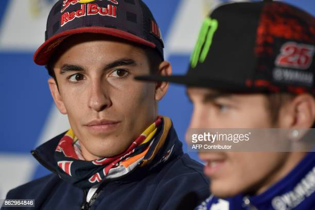 Honda rider Marc Marquez of Spain looks on as Movistar Yamaha rider Maverick Vinales of Spain listens to a question during a press conference at...