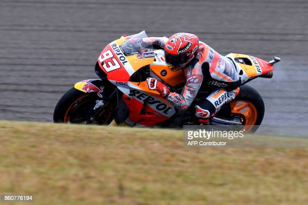 Honda rider Marc Marquez of Spain powers his machine during the second practice session of the MotoGP Japanese Grand Prix at Twin Ring Motegi circuit...