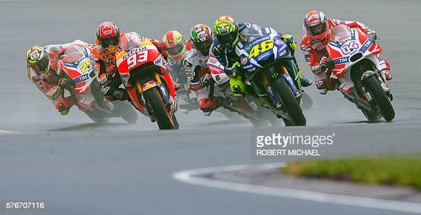 Honda rider Marc Marquez of Spain Yamaha rider Valentino Rossi of Italy an Ducati rider Andrea Dovizioso of Italy lead the pack during the MotoGP...