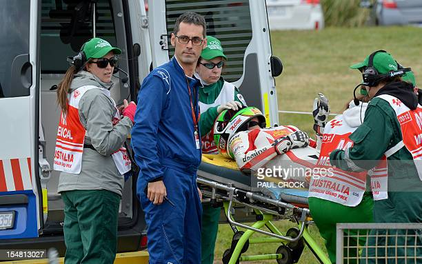 Honda rider Niccolo Antonelli of Italy is stretchered into an ambulance after crashing heavily during practice for the Moto3 class at the Australian...