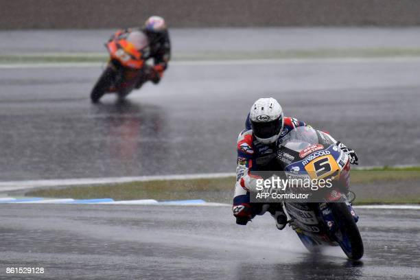 Honda rider Romano Fenati of Italy leads KTM rider Niccolo Antonelli of Italy during the Moto3 class of the MotoGP Japanese Grand Prix at Twin Ring...