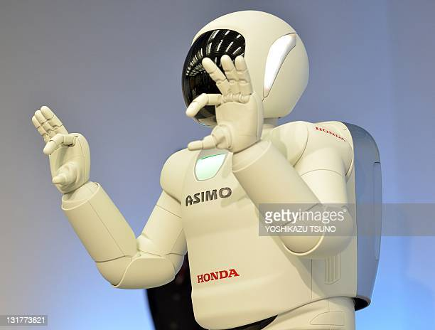 A Honda robot named 'Asimo' performs sign langage during a demonstration of its new fuctions at the company's laboratory in Wako city suburban Tokyo...