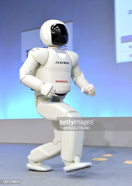 A Honda robot named 'Asimo' runs at 9kmh during a demonstration of its new fuctions at the company's laboratory in Wako city suburban Tokyo on...