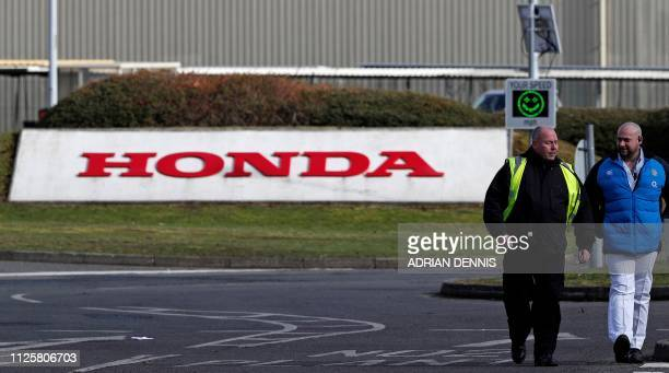 A Honda sign is pictured at an entrance to the Honda manufacturing plant in Swindon southwest England on February 19 2019 Honda will shut its UK...