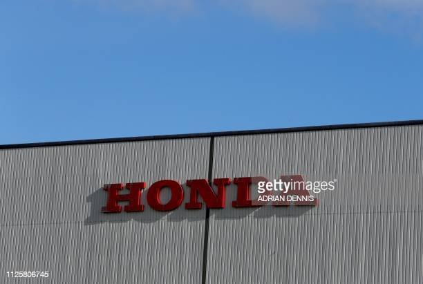 A Honda sign is pictured at the Honda manufacturing plant in Swindon southwest England on February 19 2019 Honda will shut its UK plant with the loss...