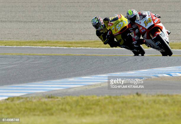 Honda Team Asia's Thai rider Ratthapark Wilairot leads Paginas Amarillas HP 40's Spanish rider Edgar Pons during the Moto2 race at the Japanese Grand...