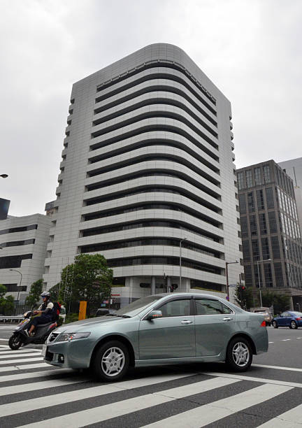 A Honda Vehicle Passes The Headquarters Of Japanese Auto Giant Motor In Tokyo On July