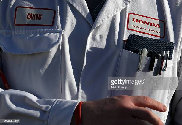 Honda worker speaks to waiting media at the Honda car assembly plant following the announcement that the firm is to axe 800 jobs on January 11 2013...