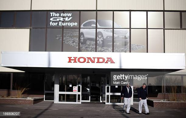 Honda workers walk from a building at the Honda car assembly plant following the announcement that the firm is to axe 800 jobs on January 11 2013 in...