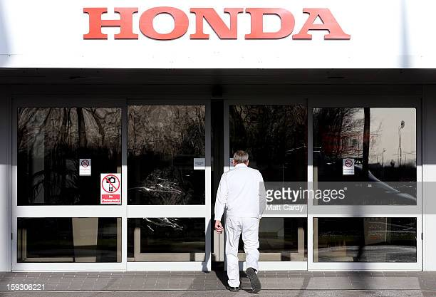 Honda workers walk into a building at the Honda car assembly plant following the announcement that the firm is to axe 800 jobs on January 11 2013 in...
