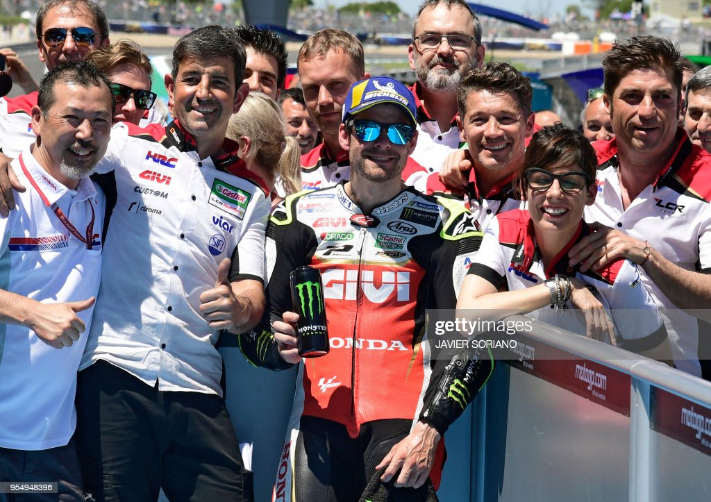LCR Honda's British rider Cal Crutchlow celebrates with his team being first placed during the MotoGP qualifying session of the Spanish Grand Prix at the Jerez racetrack in Jerez de la Frontera on May 5, 2018.