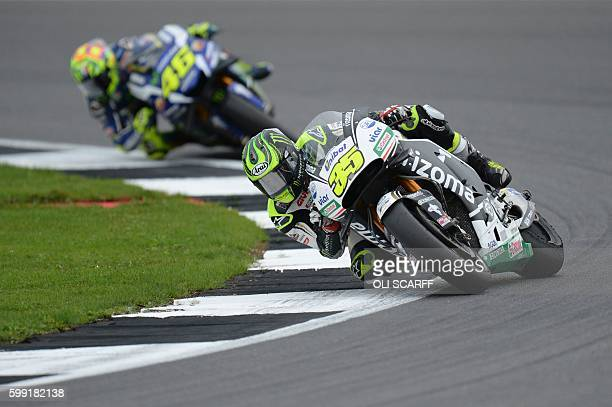 LCR Honda's British rider Cal Crutchlow enters Luffield Corner ahead of Movistar Yamaha MotoGP's Italian rider Valentino Rossi during the MotoGP race...